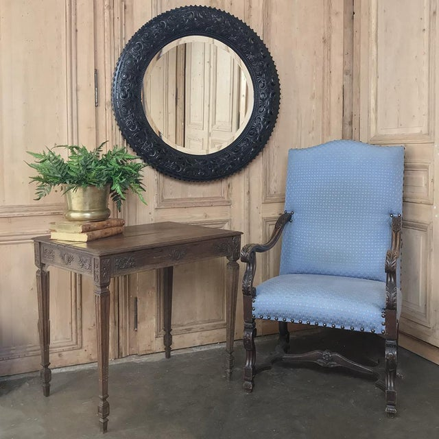 19th Century French Louis XVI Round Carved Wood Mirror represents the essence of fine wood sculpture, while providing an...