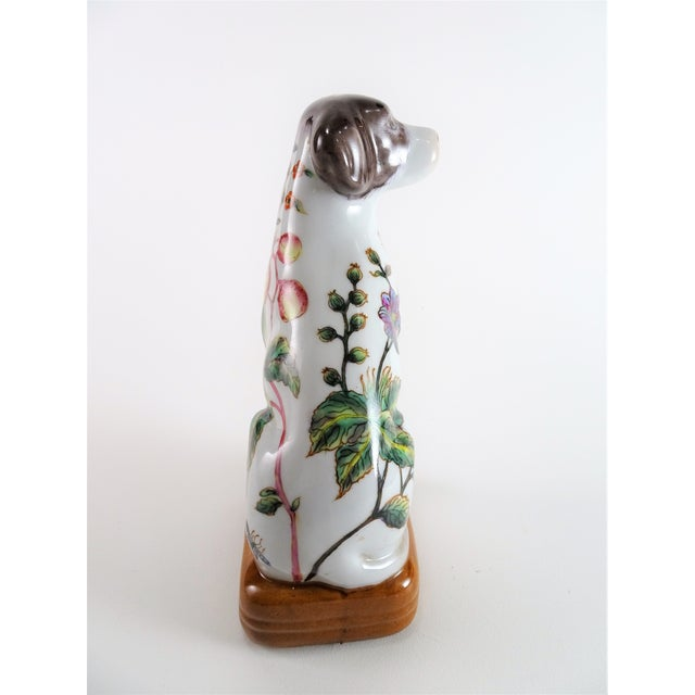 Sweet porcelain dog is hand painted beautifully with botanical flowers, fruits, and insects. Waiting and sitting patiently...