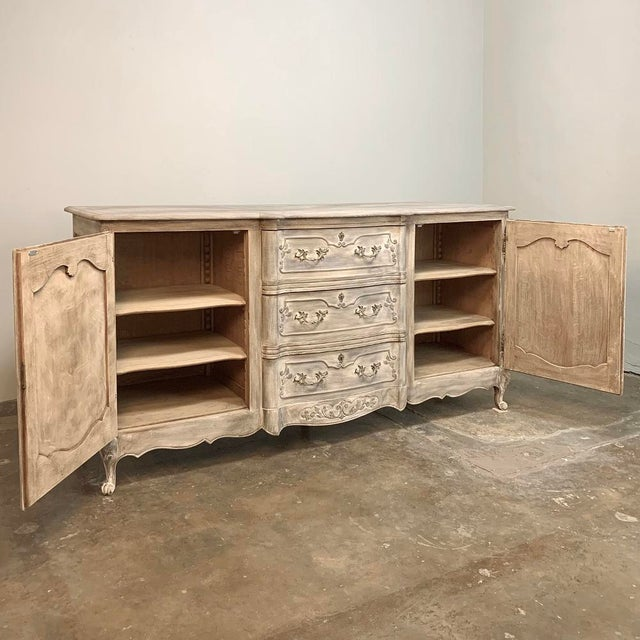 Antique French Louis XV Whitewashed Buffet is artistry in wood, with elegant molded detail providing a framework around...