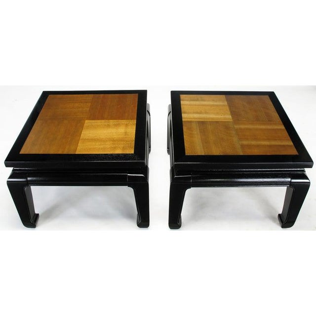 Pair of ebonized Ming style low tables with natural contrasting grain alder wood parquetry tops. Can be used as a two...