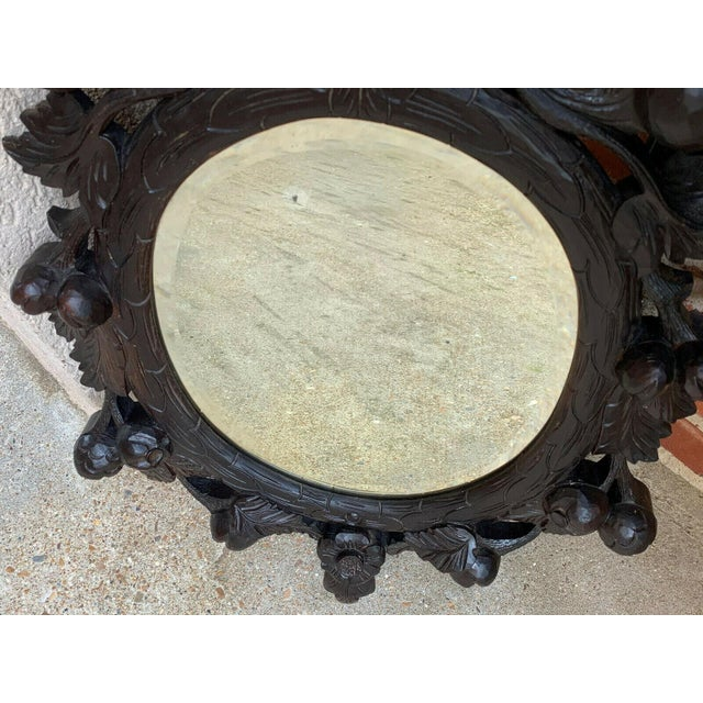 19th Century Antique English Black Forest Style Carved Dark Oak Oval Wall Mirror For Sale - Image 10 of 13