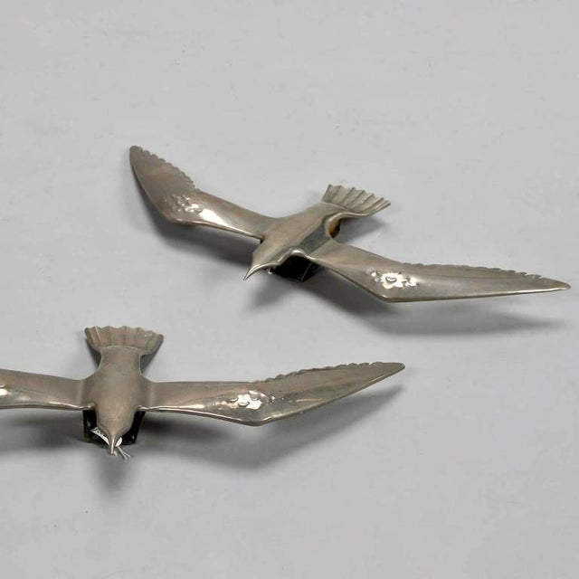 Found in Italy, this pair of circa 1970s cast aluminum seagulls can be used as wall sculptures or update the original...