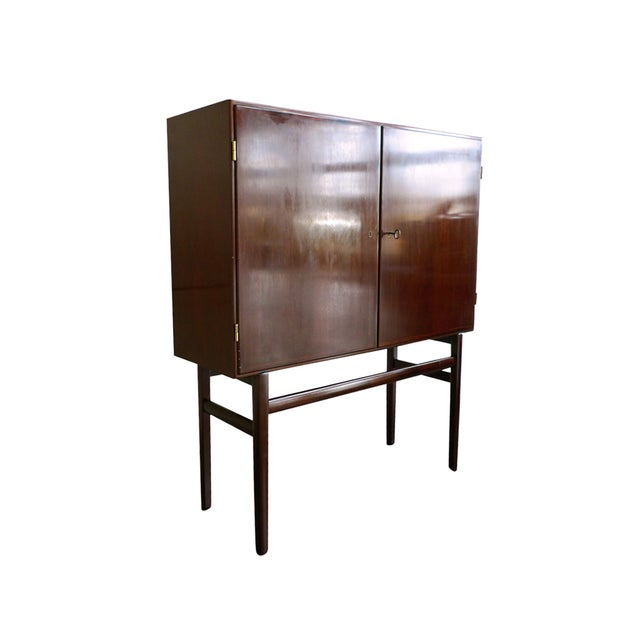 This Danish mahogany highboard, or high sideboard, was designed in the 1960s by Ole Wanscher for the manufacturer Poul...