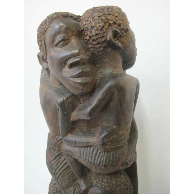 "Makonde tree of life wood carving, men encircling, made of African Blackwood (mpingo) signed Amisi at base. Measures 15""..."