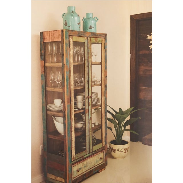Craftsmanship at its finest! Display your dinnerware or favorite items in this eclectic china cabinet. This versatile...