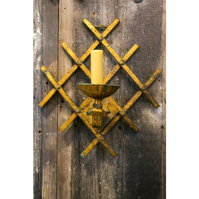 French Gilt-Iron Sconces with a Modern, Geometric Grid Design. The sconces are original gilt on iron in an interesting...
