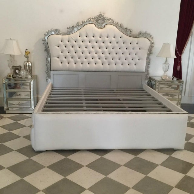 French baroque style bed frame in silver finish. Newly upholstered in white faux leather with black button tufted. This...