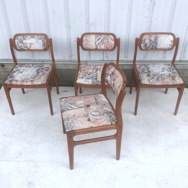 This impressive set of four Danish modern dining chairs features quality mid-century teak construction with unique...