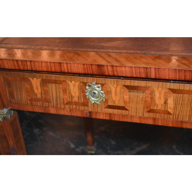 Fantastic French transitional kingwood two-drawer desk with parquetry inlays. Having lovely geometric inlays on all sides,...