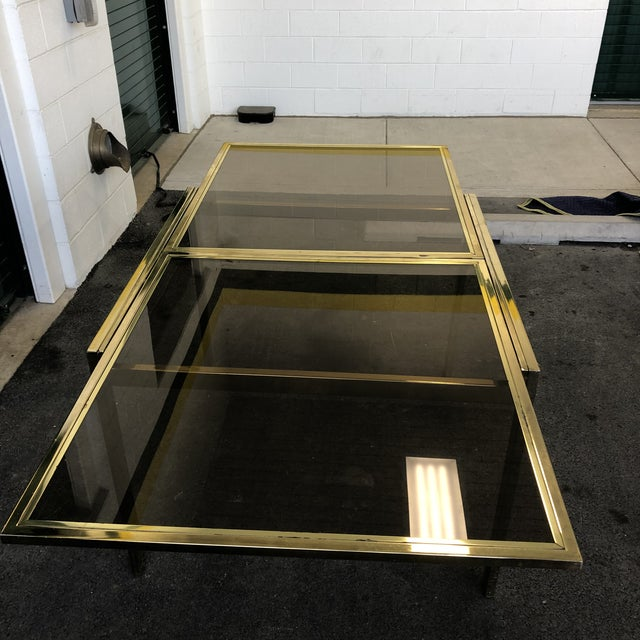 """vintage DIA brass lacquer and glass expanding dining table. The table measures 40""""long x 40"""" wide x 30"""" high when closed...."""