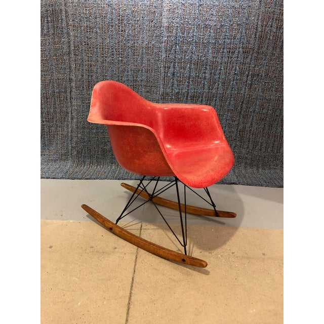 Iconic red fiberglass molded plastic rocking chair with black enamel base and birch rocking struts, circa 1960's. Second...