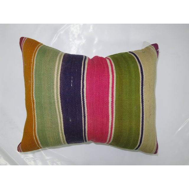 Pillow made from a Vintage Turkish Kilim with solid cotton back. Zipper closure and foam insert provided.