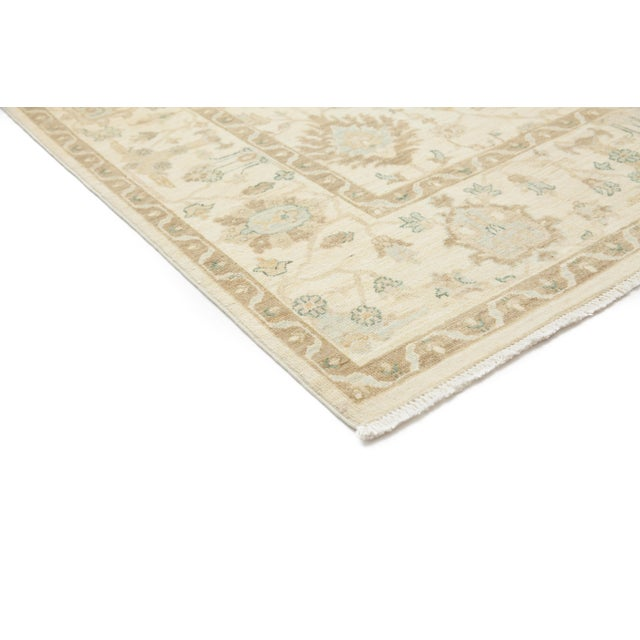A hand knotted Turkish Oushak inspired rug. The Turkish city of Oushak was a major rug production center during the...