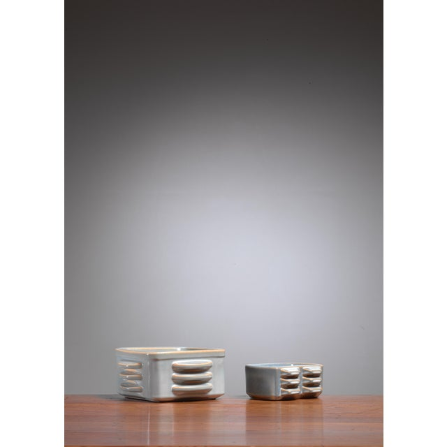 A pair of ceramic bowls, one rectangular and one square, by Einar Johansen for Søholm. The measurements stated are of the...
