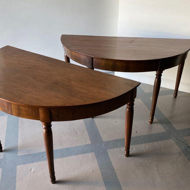Pair of antique Italian demilune consoles, can be put together to make a round table. Height: 31″ Width: 61.5″ Depth: 30.5″