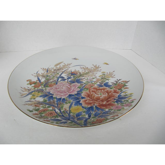 Beautiful large white porcelain chinoiserie plate with pink, orange and blue flowers and plants and two butterflies flying...