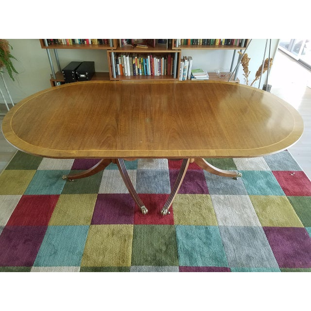"""Two pedestal light mahogany dining table with two leaves and rosewood inlay. Very good condition, solid. 42.25"""" Wide,..."""