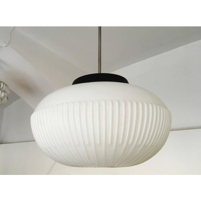 Opaline sphere shade with a ridged side made in the 1970s. Up to 14 pieces available.