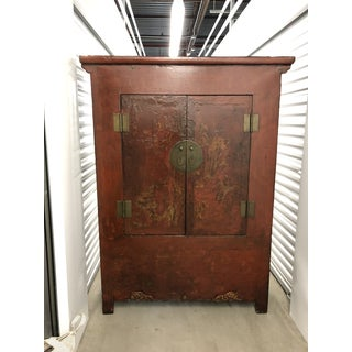 Vintage Dark Wood Armoire With Red Detailed Front Preview
