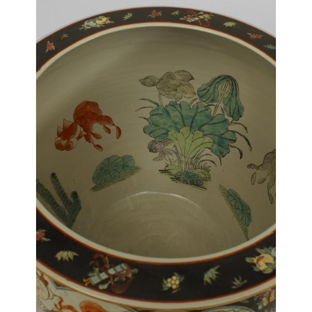 Asian Chinese style (19/20th Cent) black & white jardiniere (fishbowl) with 4 scenes with figures and decorated on inside