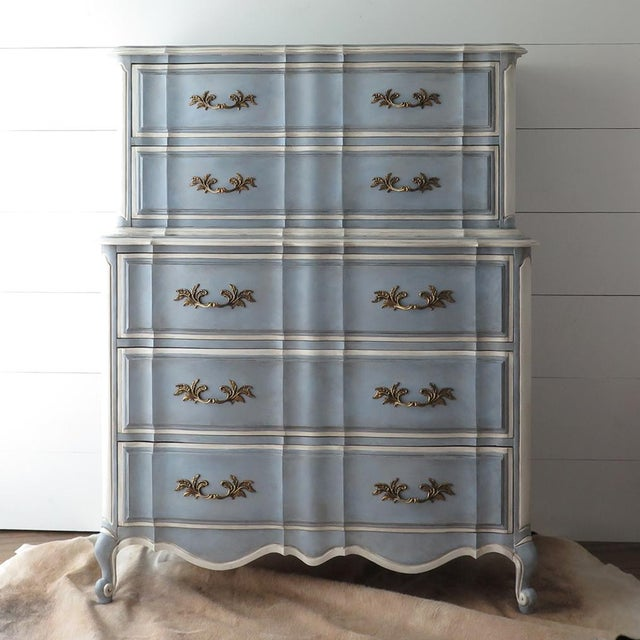This vintage French Provincial Highboy or chest on chest dresser is stunning! Painted in layers of cream and blue, it is...