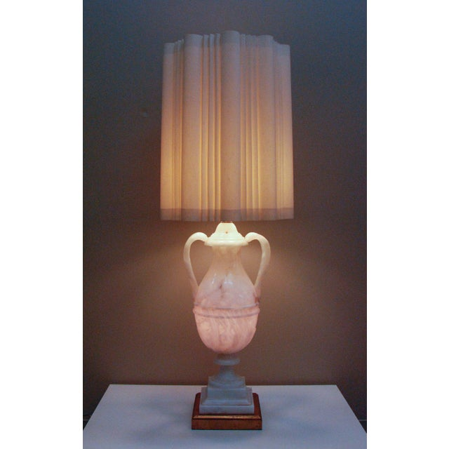 A monumental hand-carved Hollywood Regency Italian alabaster lamp, circa 1950 A breathtakingly large and impressive urn...