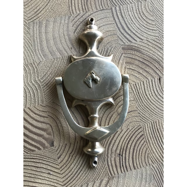 This vintage door knocker is so charming! It's classic style is accented with a whimsical terrier dog focal point perfect...