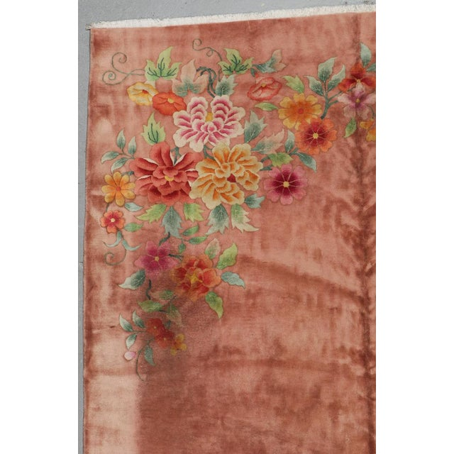 Chinese Art Deco Rug, Early 20th century, beautiful dusty salmon color with floral spray detail in corners, measuring...