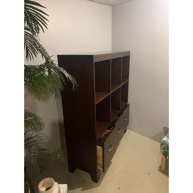 Solid wood cabinet with 3 lower filing drawers. I have used this in my office behind my desk and also in my dining room...