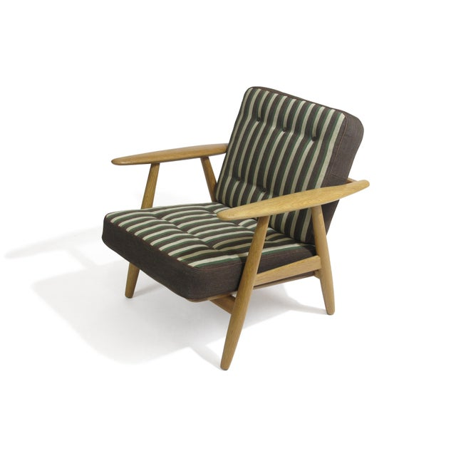 1950's Hans Wegner Cigar lounge chair crafted of solid white-oak. The original striped wool upholstery is in excellent...