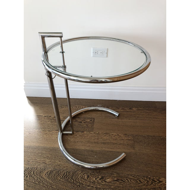 Adjustable height chrome & glass accent table by Eileen Gray. Made in the 1980s. Smallest height = 25.5 inches Highest...