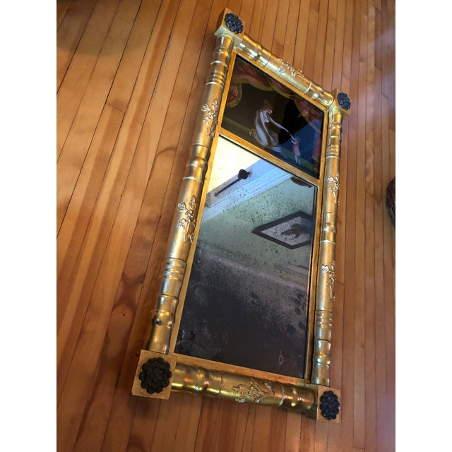 Circa 1820-25 American Gilt Eglomise Reverse Painted Mirror with Original Glass and Mirror. Updated Gilt professionally...