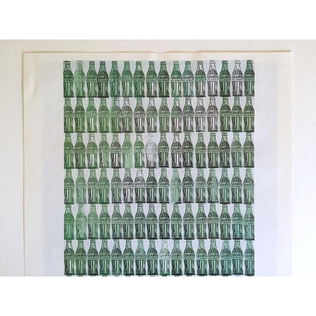"""This Andy Warhol Foundation vintage 1999 Pop Art offset lithograph calendar Print """" Green Coca - Cola Bottles """" 1962, is a..."""