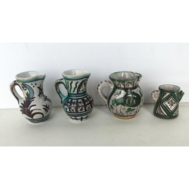 bout Set of four Glazed Terrracota Vases , Urns in Green & White Measurements: Hight: 4.52in Diameter: 2.95in Hight:...