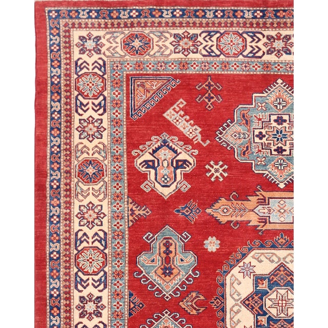 Kazak rugs are famed for their assertive, geometric drawings, rich colors, and bold, large-scale designs. The lustrous...