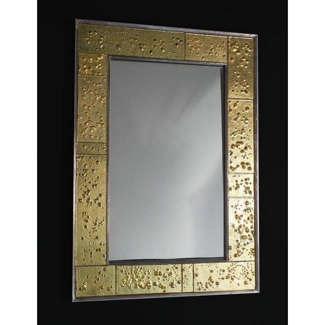 A mirror by Mary Kuzma Finishing, Inc. exclusively for Victoria & Son made of sections of hand-crafted textured glass,...