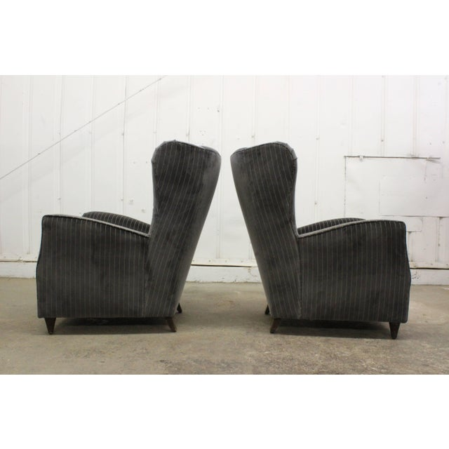 Pair of high back armchairs by Paolo Buffa, Italy, 1950s. The pair has been recently upholstered in a grey and beige...