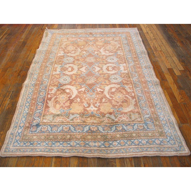"""This is a vintage cotton agra rug from 1910 India. The size is 4'2""""x6'8"""". It is tan, peach, blue, and white. There are..."""