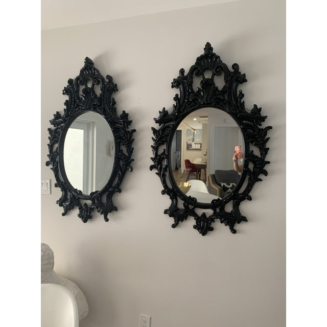 Baroque, Rococo style black satin lacquered mirrors. Ornate designs consisting of shell and leaf shapes. Mirrors made of...
