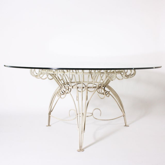 "Round metal dining table with clear glass top, c. 1950 60"" diameter X 28"""