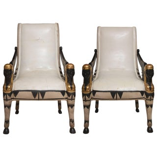 Pair of Painted and Parcel Egyptian Revival Armchairs For Sale