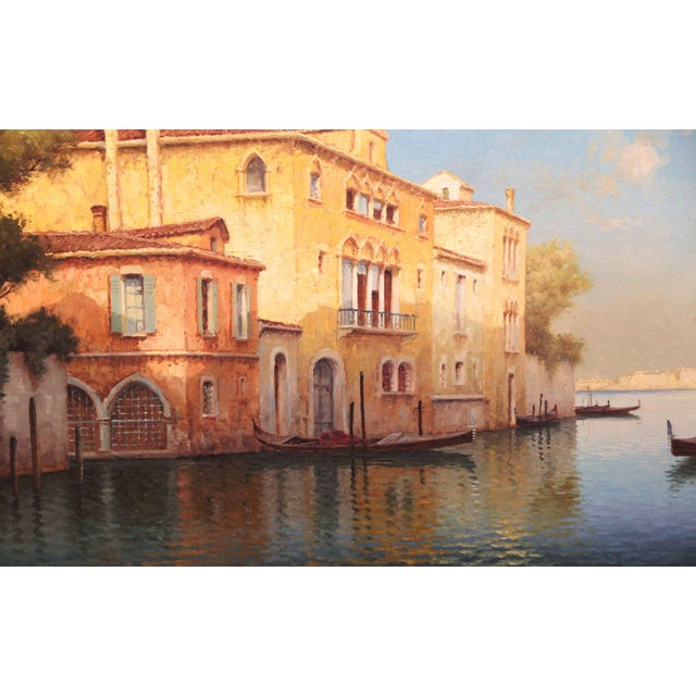 Large and colorful antique painting of the Grand Canal in Venice in original carved frame. The art work depicts a sunset...