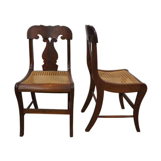 Mid 19th century Empire dining chairs. Made from walnut with crotch walnut back support and cane seat. Includes free...