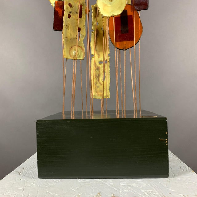 """A large 53"""" kinetic sculpture by Curtis Jere completed in the 1950s using color-blocked fused glass panels each metal..."""