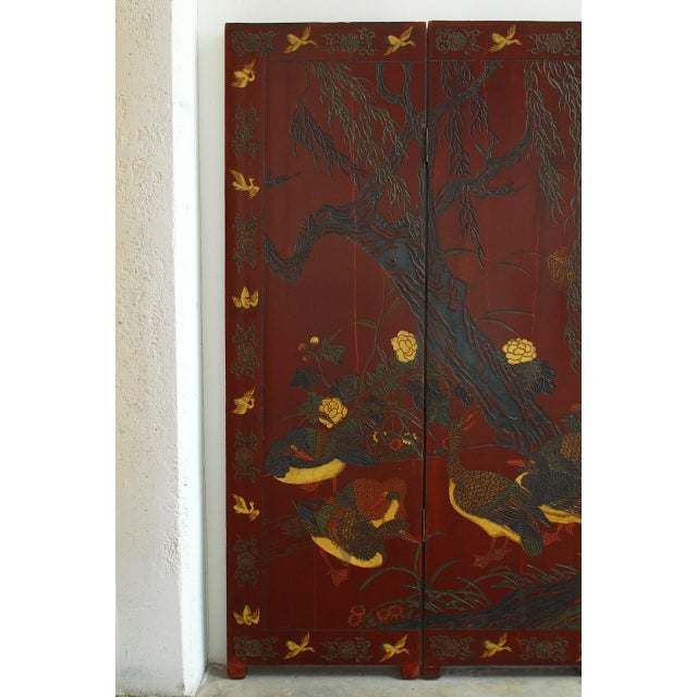 Distinctive Chinese two-sided lacquer carved screen of ducks and geese landscape. Made in a Coromandel style with carved...
