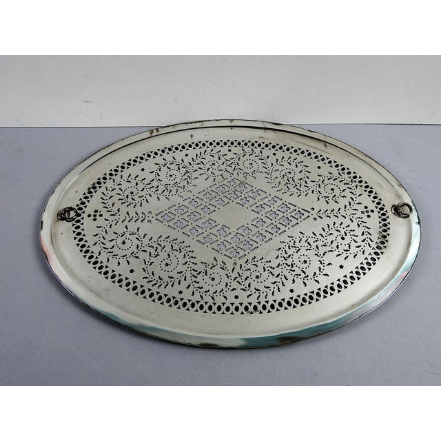 Circa 1815 Sheffield silverplate over copper and hand pierced mazarine tray (strainer). No markings, attached rings for...