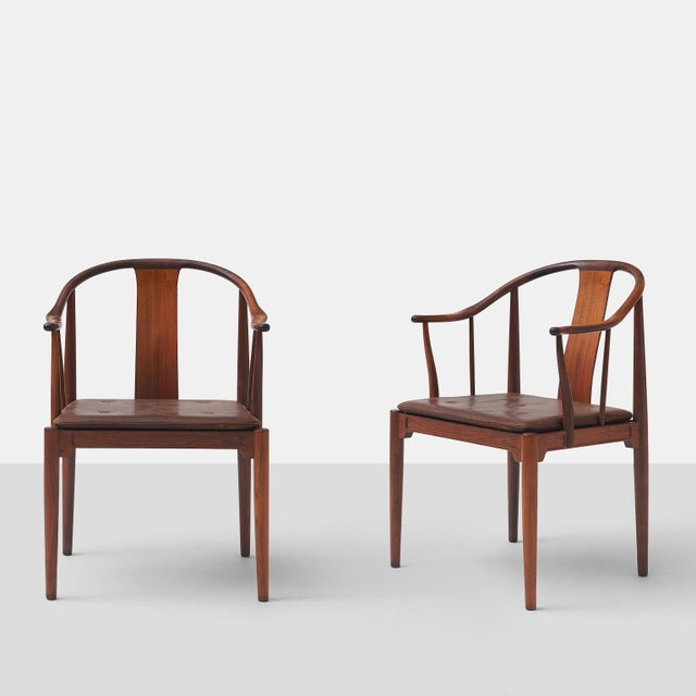 """Pair of Rosewood """"China"""" Chairs by Hans J Wegner A pair of lounge chairs in rosewood with loose seat cushion upholstered..."""