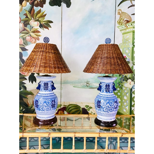 Manifest joy and harmony with this pair of double happiness lamps. This pair features vintage rattan Coolie shades and...