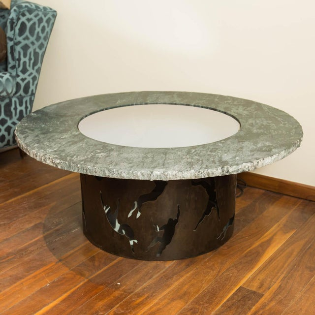 Made from soapstone and patinated steel, this one of a kind center hall table makes a dramatic entrance. Lighting and...