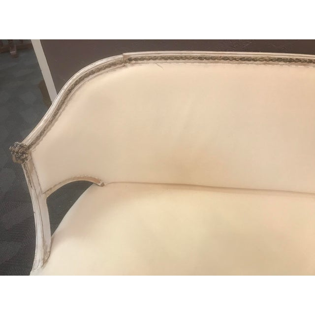 This is an antique Swedish Settee with original paint circa 1780. It is covered in an off white muslin.